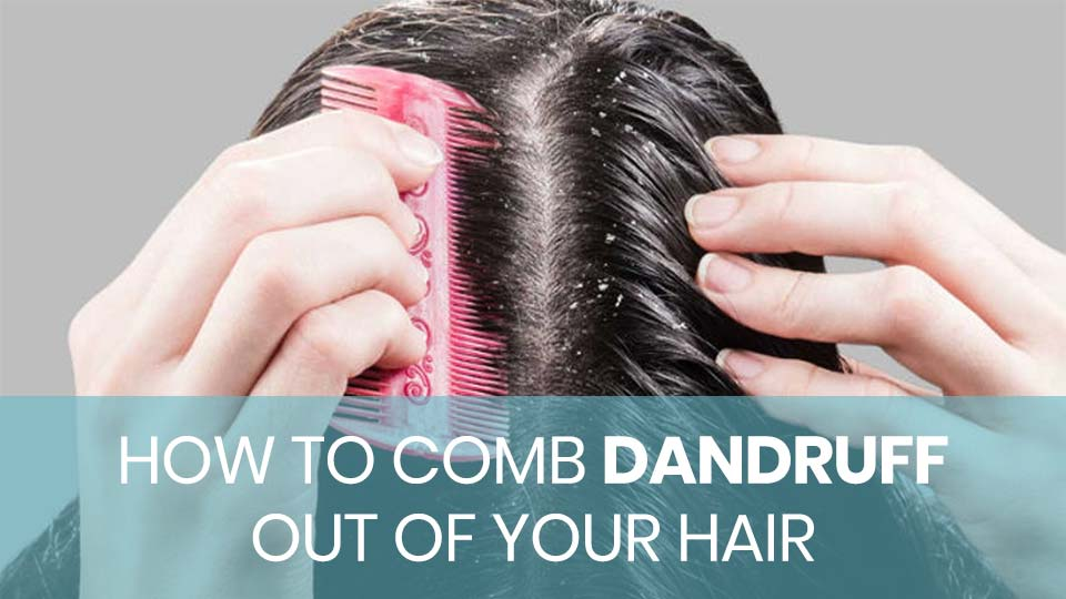 A woman combing dandruff out of her hair