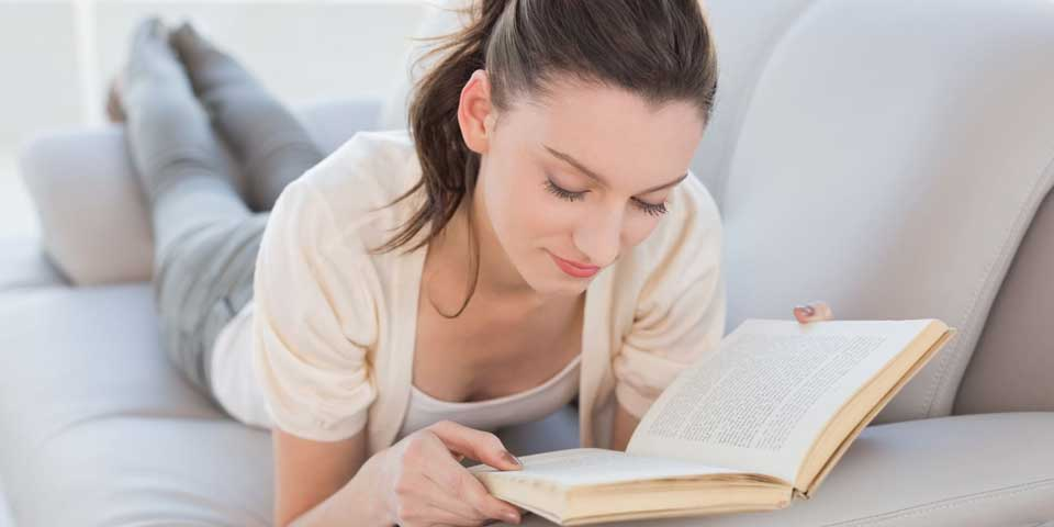 A woman reading a book about dandruff